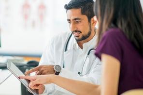 male-doc-tablet-patient-in-purple.jpg